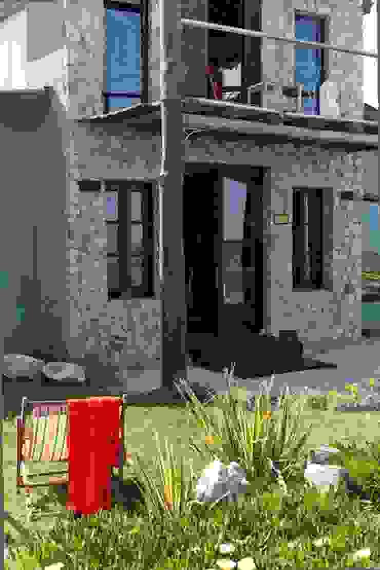 Casa Claudia Carboni Casas rústicas de Susana Bellotti Arquitectos Rústico
