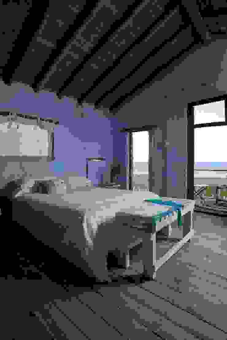 Casa Claudia Carboni Dormitorios rústicos de Susana Bellotti Arquitectos Rústico