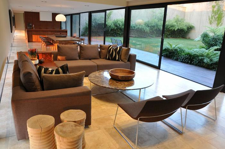 Lee Ann & Marcus' House Modern living room by www.mezzanineinteriors.co.za Modern