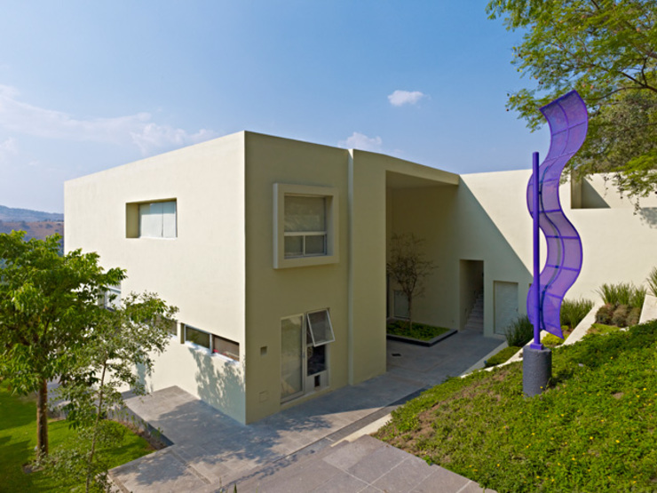 FACHADA LATERAL Casas minimalistas de Excelencia en Diseño Minimalista Ladrillos