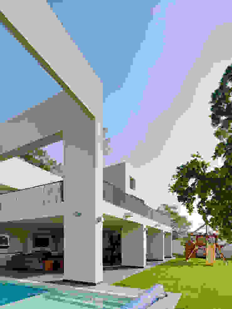 RESIDENCIA OROZCO Casas minimalistas de Excelencia en Diseño Minimalista Concreto