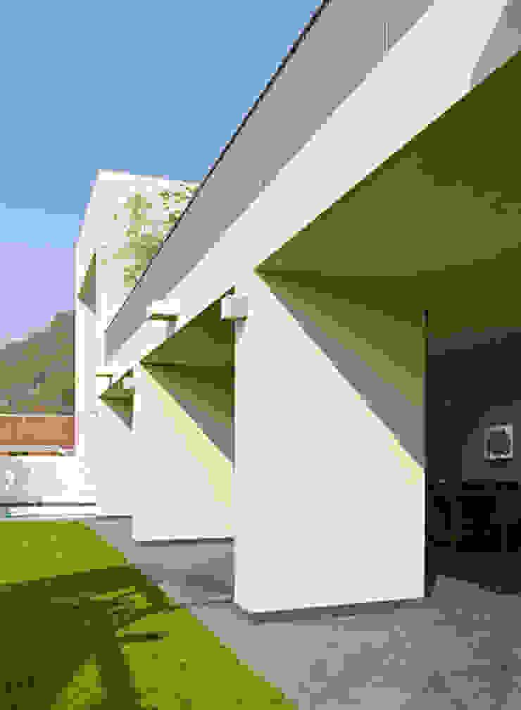 TERRAZA Casas minimalistas de Excelencia en Diseño Minimalista Ladrillos