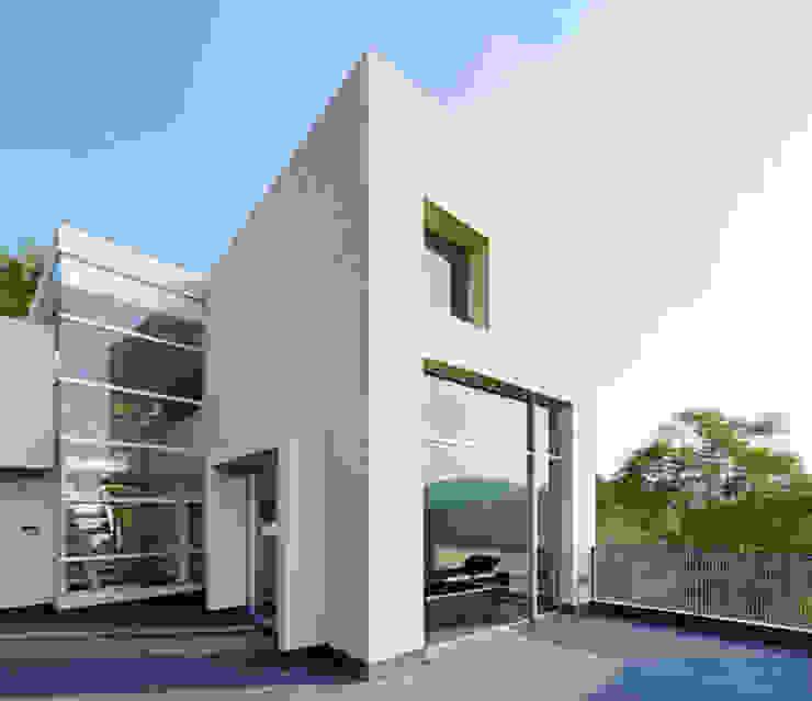 FACHADA POSTERIOR Casas minimalistas de Excelencia en Diseño Minimalista Concreto