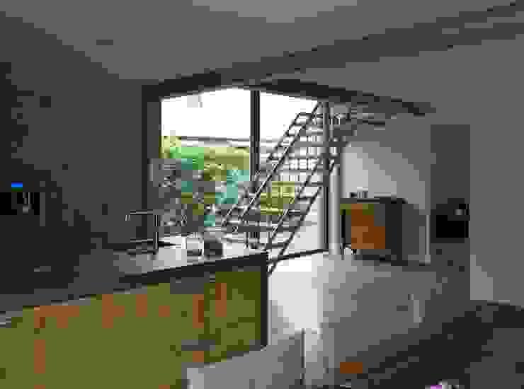Industriele uitstraling met stalen balken Industrial style kitchen by Villa Delphia Industrial