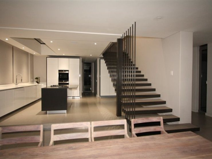 Staircase E2 Architects Minimalist kitchen Iron/Steel Grey