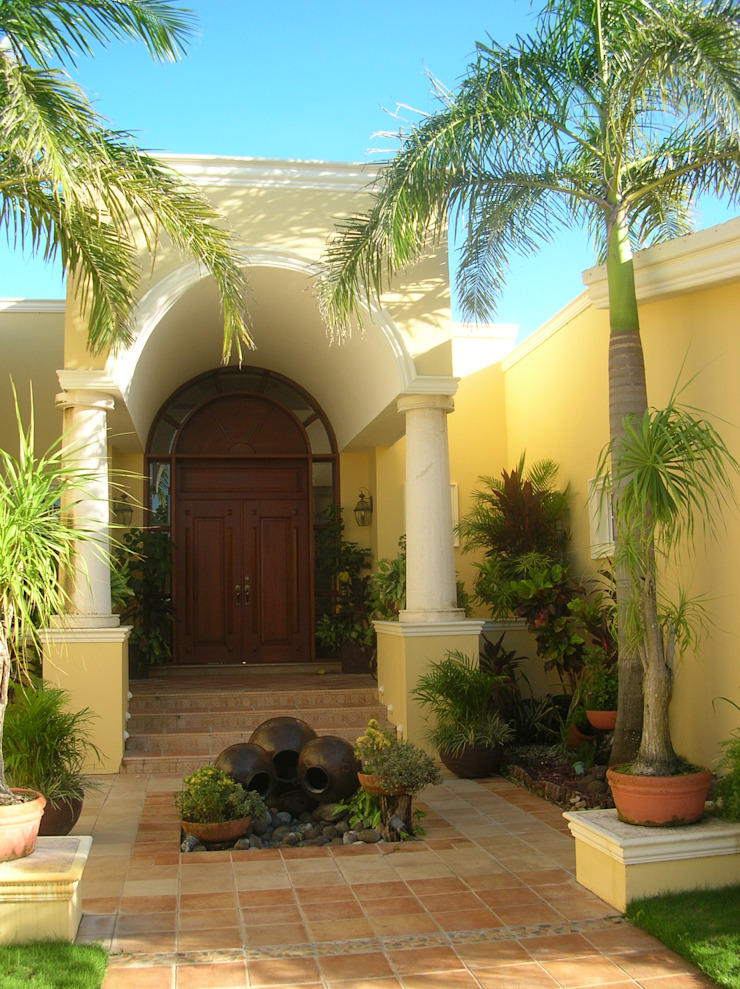 CASA AMARILLA / YELLOW HOUSE de SG Huerta Arquitecto Cancun Ecléctico Ladrillos