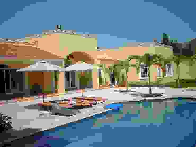 CASA AMARILLA / YELLOW HOUSE de SG Huerta Arquitecto Cancun Ecléctico Azulejos