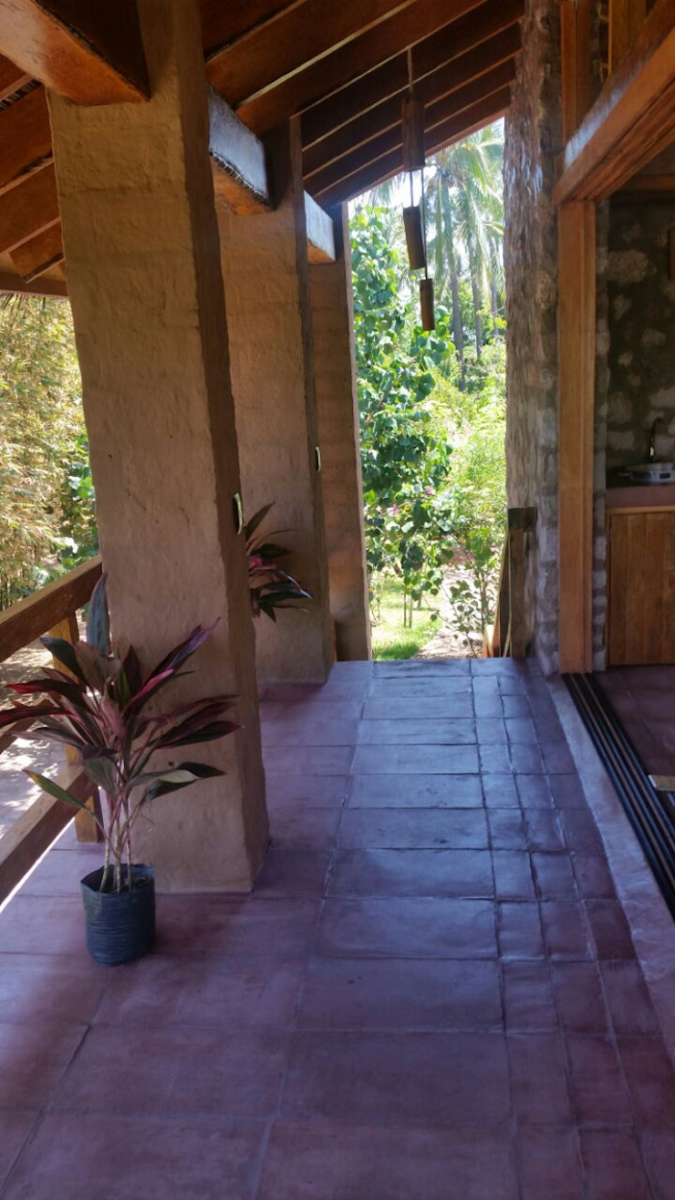 TERRAZA DE RECÁMARA Balcones y terrazas rústicos de Cervantesbueno arquitectos Rústico Piedra