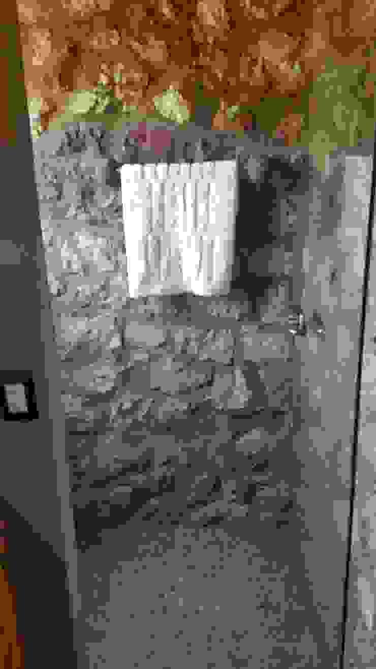 REGADERA Baños rústicos de Cervantesbueno arquitectos Rústico Piedra