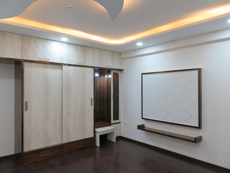 wardrobe, dress & LCD unit Modern style bedroom by Bluebell Interiors Modern Plywood