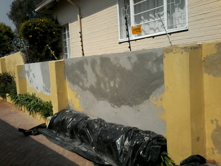 Painting of home exterior walls Industrial style houses by Nozipho Construction Industrial