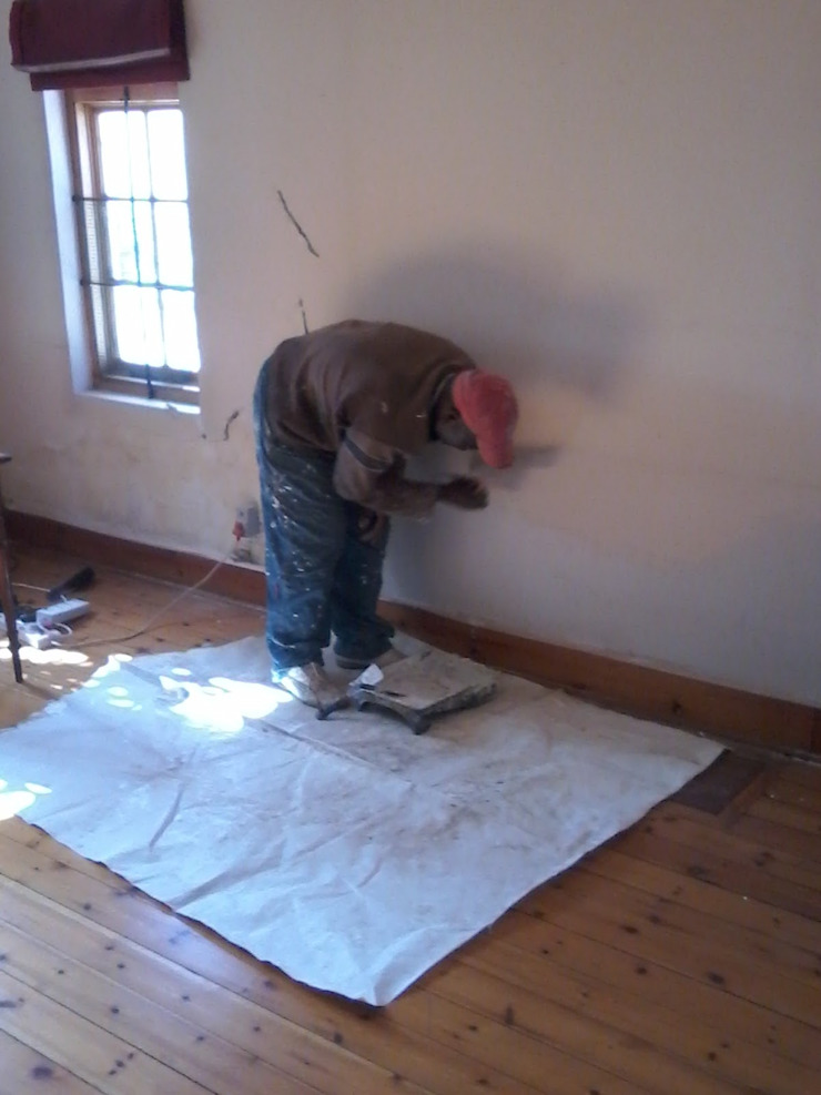 Painting Interior of House Industrial style houses by Nozipho Construction Industrial