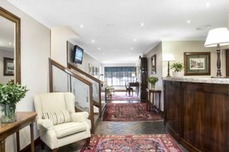 The Falstaff—Boutique Hotel Sandton by Nowadays Interiors Colonial Wood Wood effect