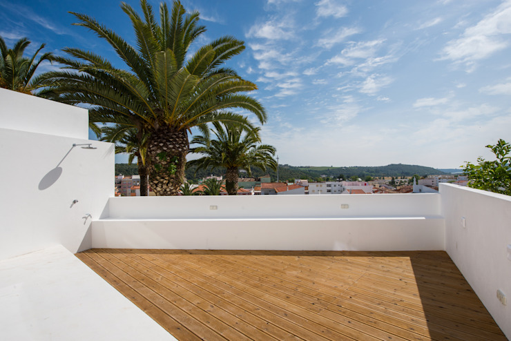 Casas de estilo minimalista de studioarte Minimalista Madera Acabado en madera