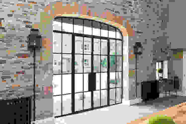 Bronze Screen with Slimline Doors on a Yorkshire Barn Conversion Architectural Bronze Ltd Windows & doors Doors Copper/Bronze/Brass Brown