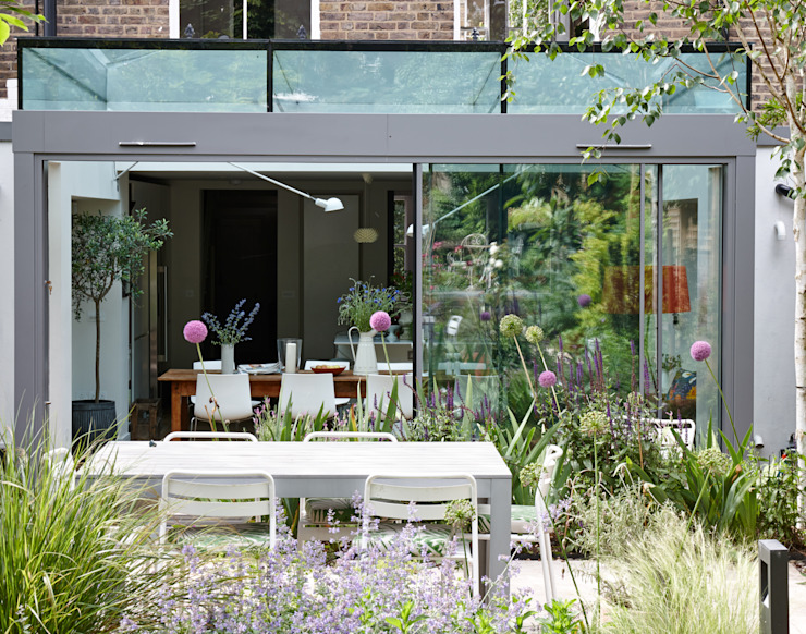 Single Storey Rear structurally glazed Extension with minimal frame triple track sliding doors Trombe Ltd Modern Dining Room Glass Grey