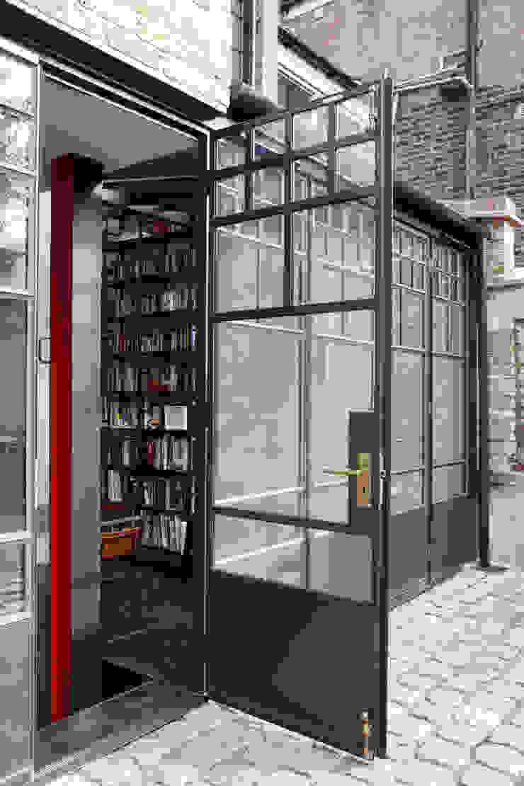 An external shot of steel doors Trombe Ltd Modern Windows and Doors Metal Black