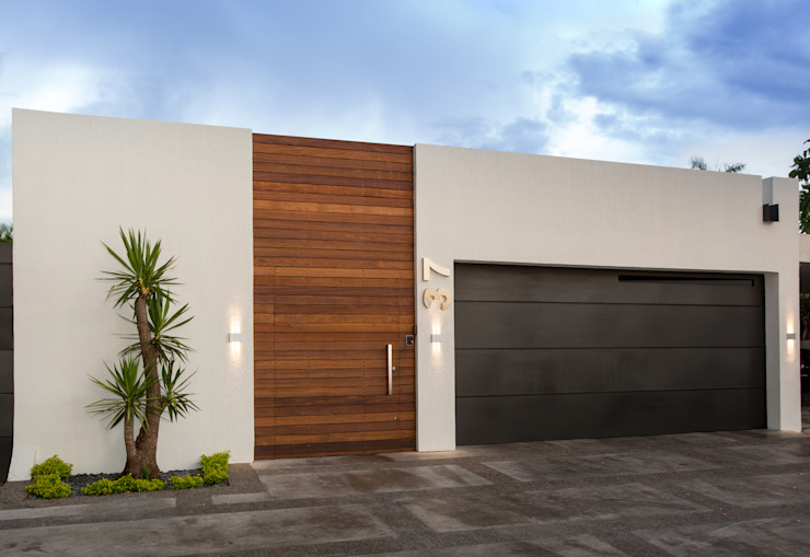 Houses by Grupo Arsciniest, Minimalist Wood Wood effect