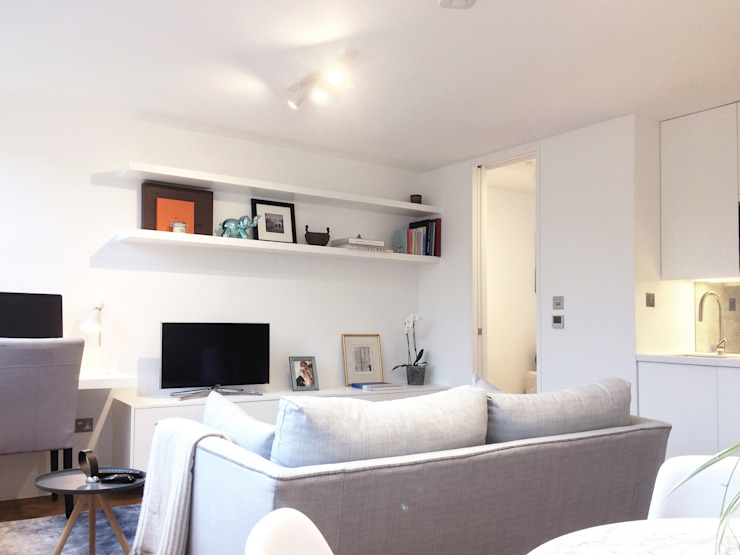 Refurbishment of a 250sqft apartment next to Hyde Park, London, W2:  Living room by GK Architects Ltd,