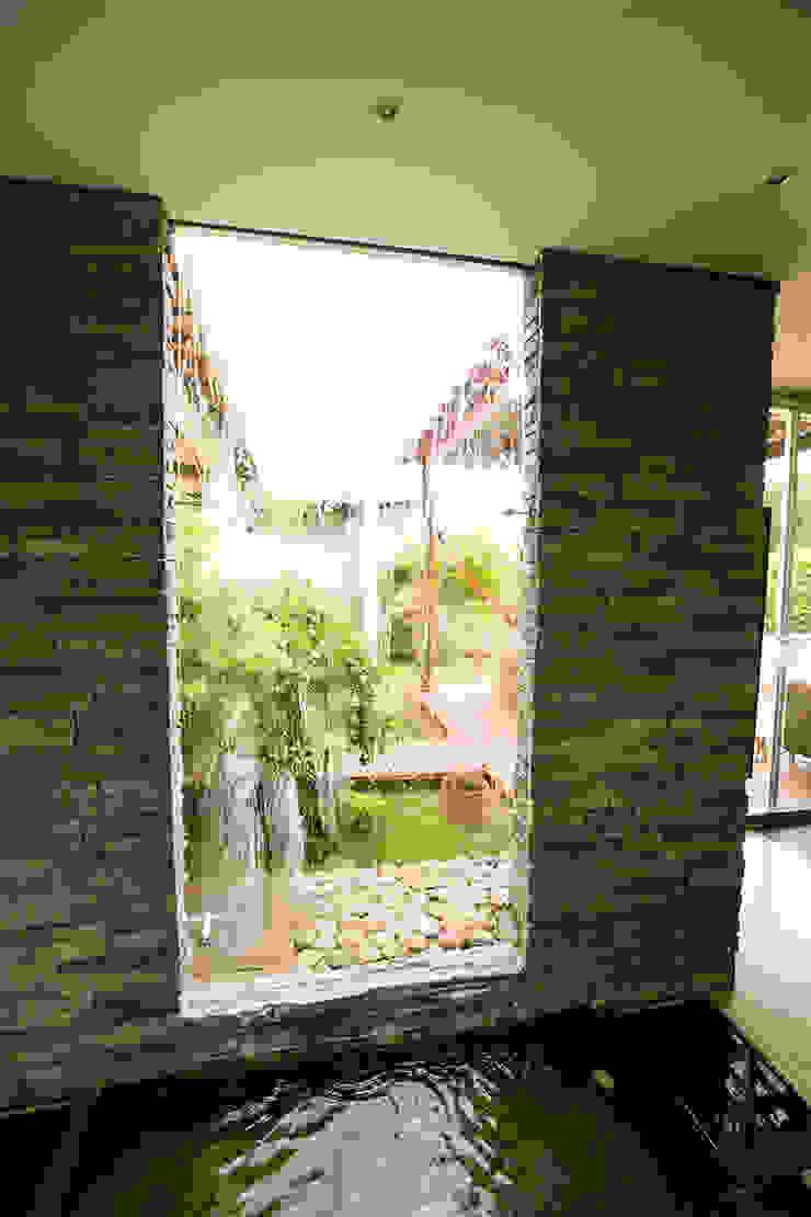 Fuente principal Jardines de estilo tropical de Arquitectura Positiva Tropical