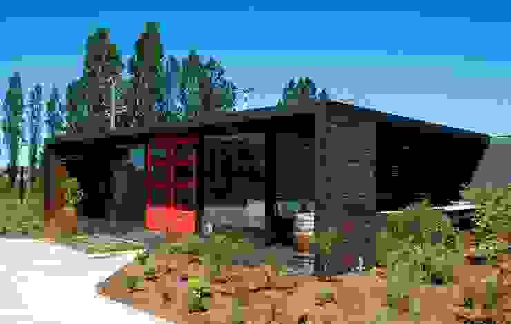 Emporio Casas modernas de james&mau Moderno