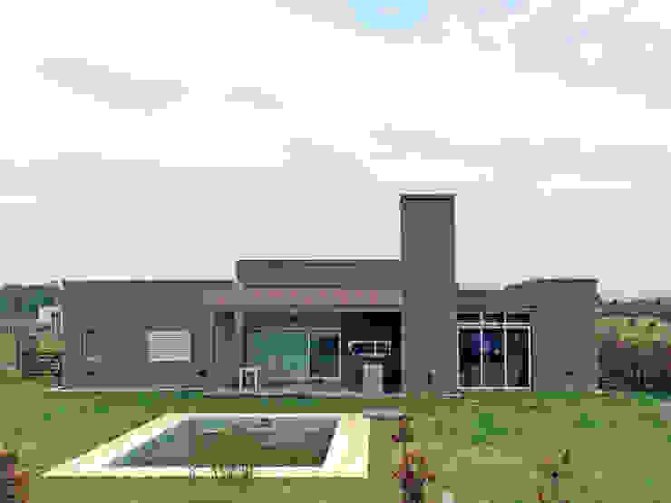Galeria Casas modernas de TORRETTA KESSLER Arquitectos Moderno Aluminio/Cinc