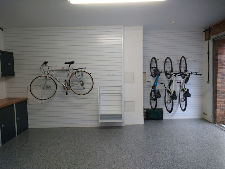 Resin Floor, Metal Cabinets and Bike Storage Galore in this lovely garage makeover in Cambridge Modern garage/shed by Garageflex Modern