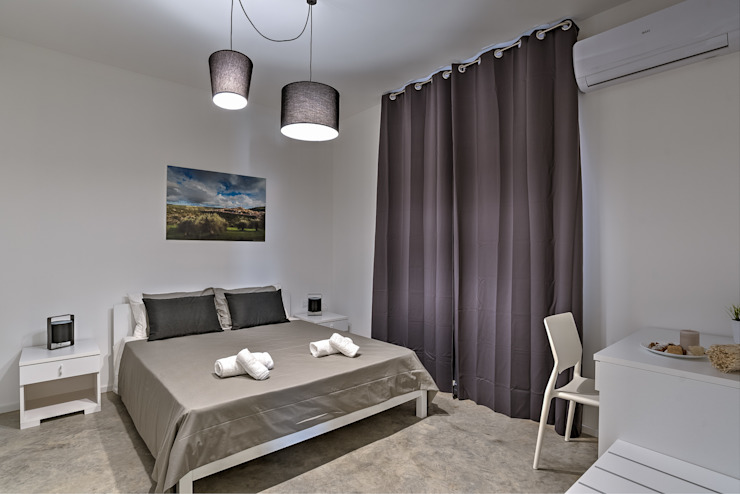 Bedroom by DFG Architetti,