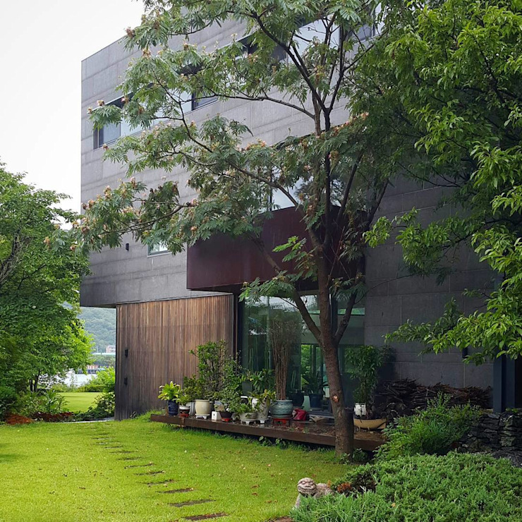 SUIP 777 RESIDENCE 모던스타일 주택 by HJL STUDIO 모던 대리석