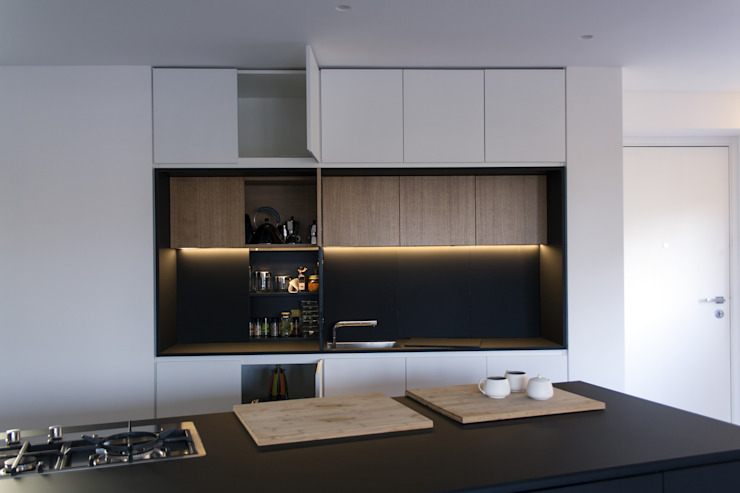 Minimalist kitchen by Studio DiDeA architetti associati Minimalist