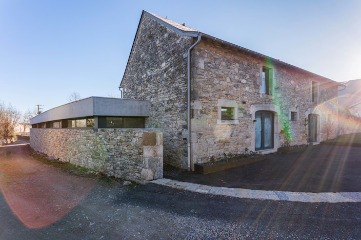Industrial style houses by Hugues TOURNIER Architecte Industrial