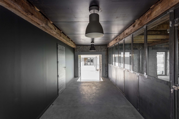 industrial style corridor, hallway & stairs by Hugues TOURNIER Architecte Industrial