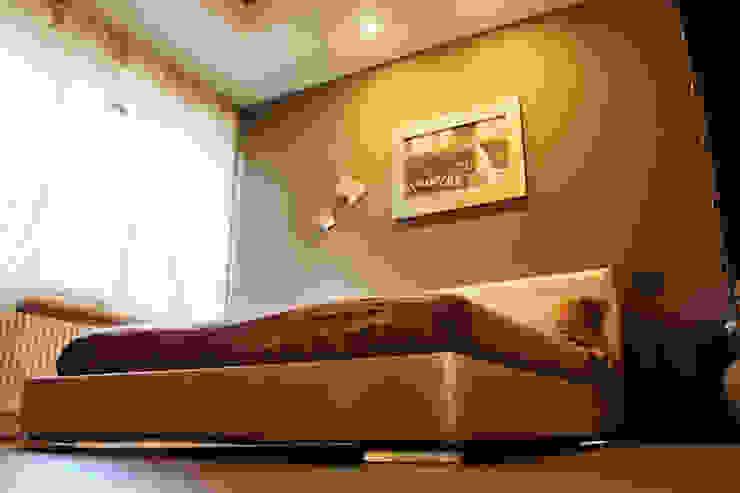Chambre moderne par Studio 06 Moderne