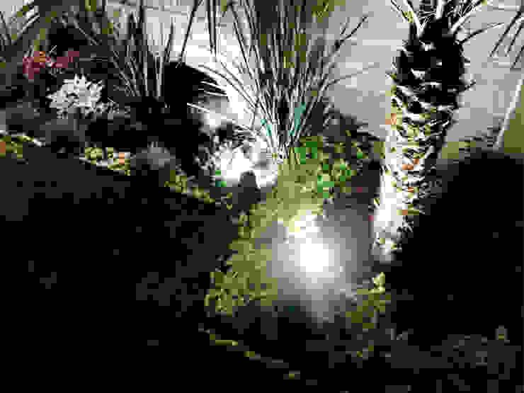Jardines de estilo  de Arqca,