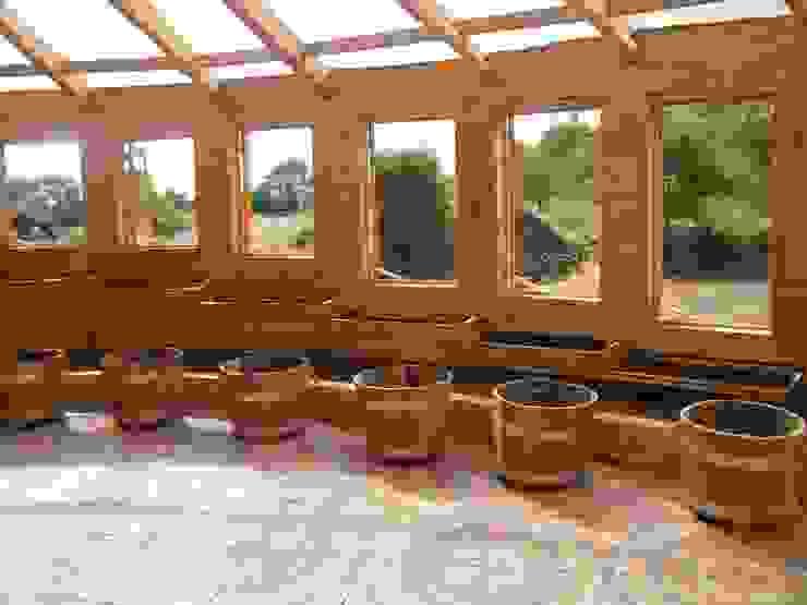Casa Sol en Rari Jardines de invierno de estilo rústico de Secrea Rústico
