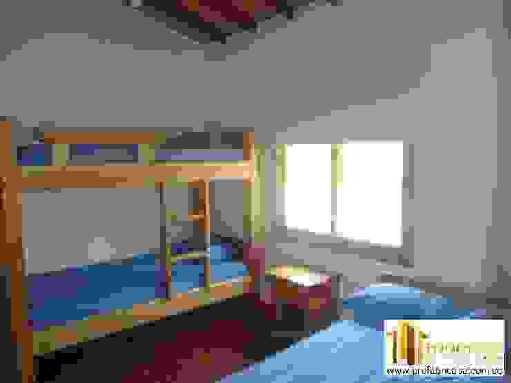 Casa Prefabricada en Bogota Habitaciones de estilo tropical de PREFABRICASA Tropical