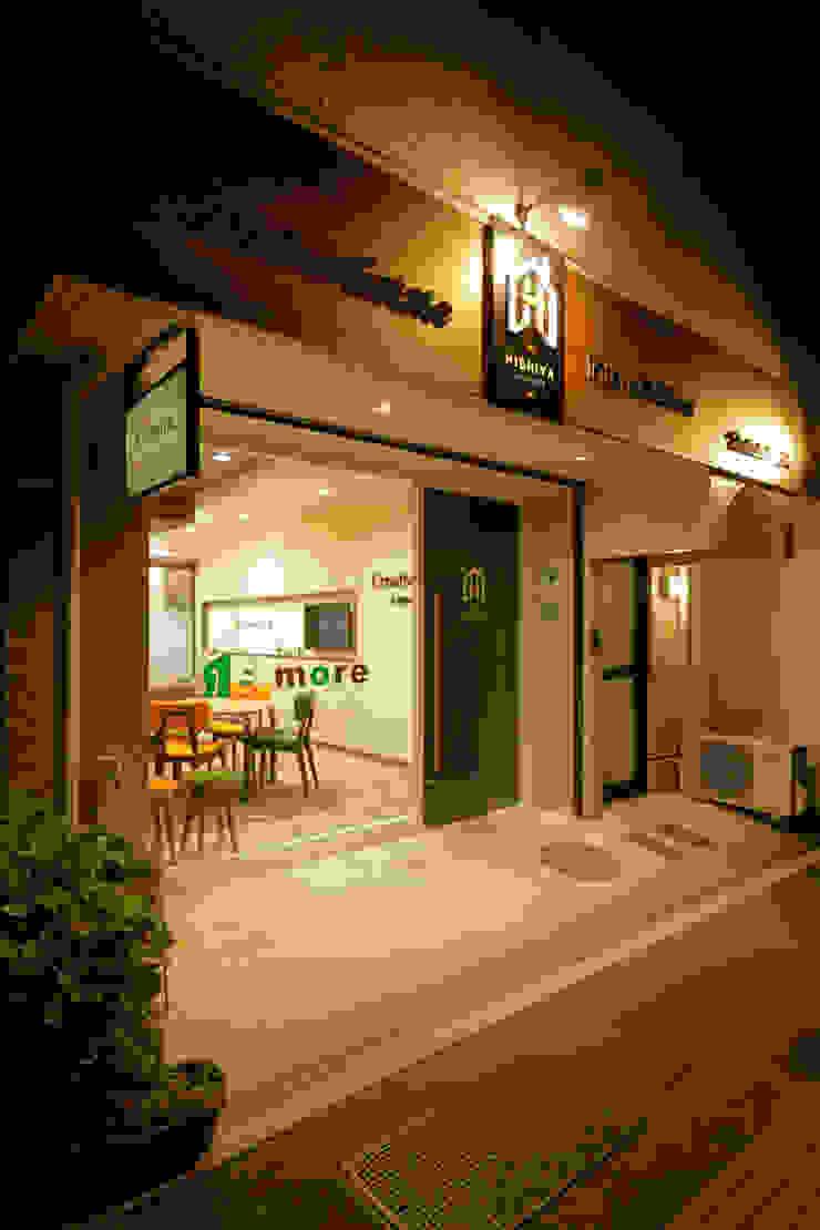 株式会社Juju INTERIOR DESIGNS Oficinas y Tiendas Madera Naranja