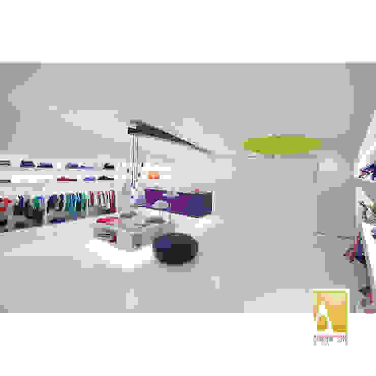 Loja de roupa de criança Lojas e Espaços comerciais modernos por Albertina Oliveira-Arquitetura Unipessoal Lda Moderno