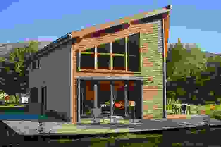 Дома в . Автор – Falco Construction Bois, Модерн Дерево Эффект древесины