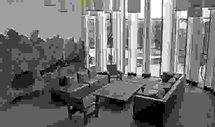 Casa de Piedra - Juan Carlos Loyo Arquitectura Salones modernos de Juan Carlos Loyo Arquitectura Moderno