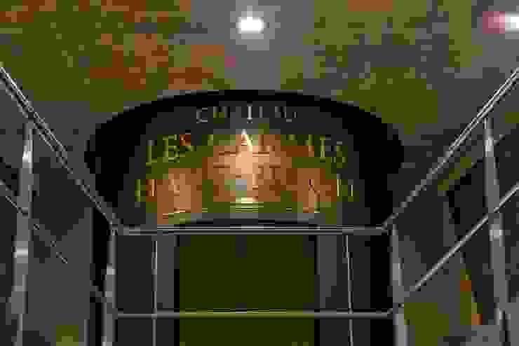 Philippe Starck's new stunning cellar at Château Les Carmes Haut-Brion Modern wine cellar by Il Pezzo Mancante Srl Modern