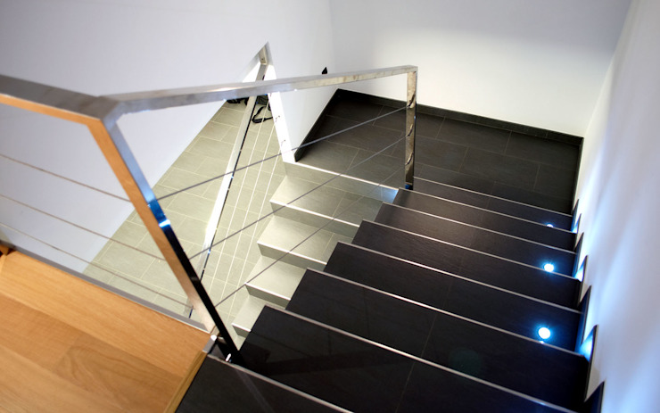Modern Corridor, Hallway and Staircase by Intra Arquitectos Modern