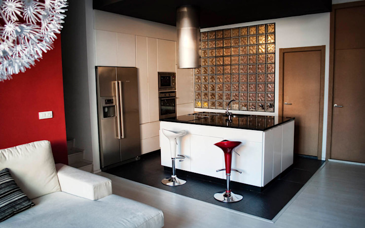Modern style kitchen by Intra Arquitectos Modern