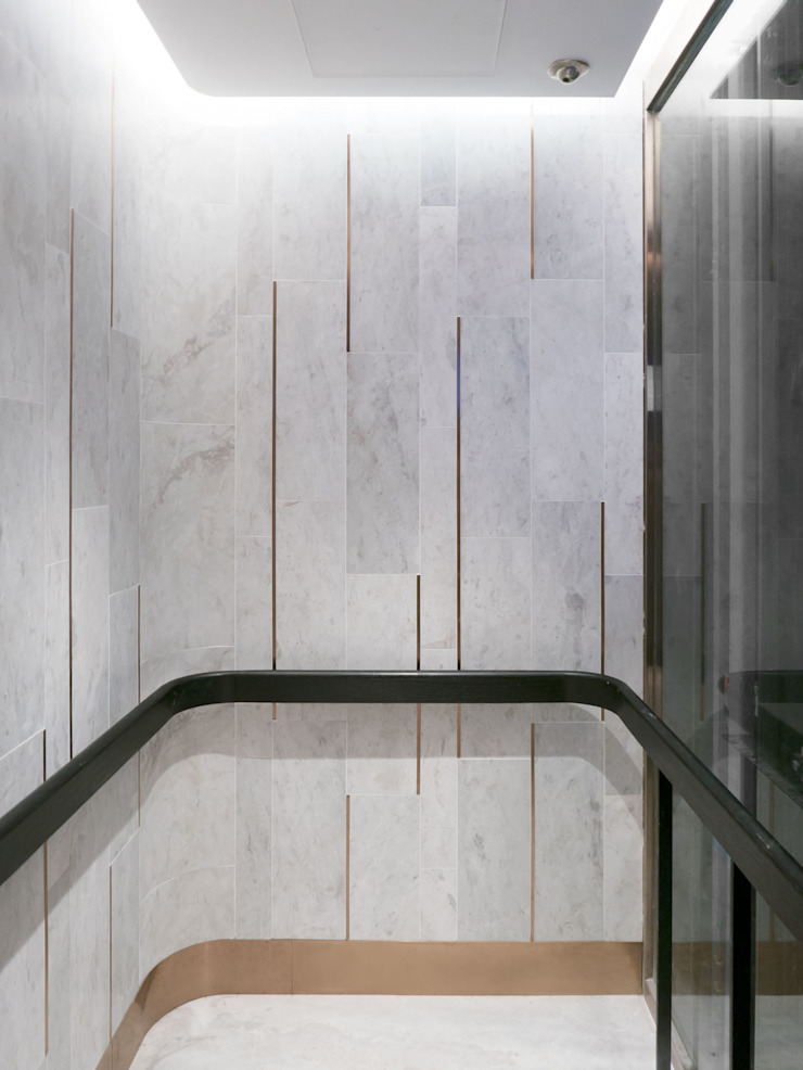 Passenger Lift Modern corridor, hallway & stairs by Sensearchitects_Limited Modern Stone