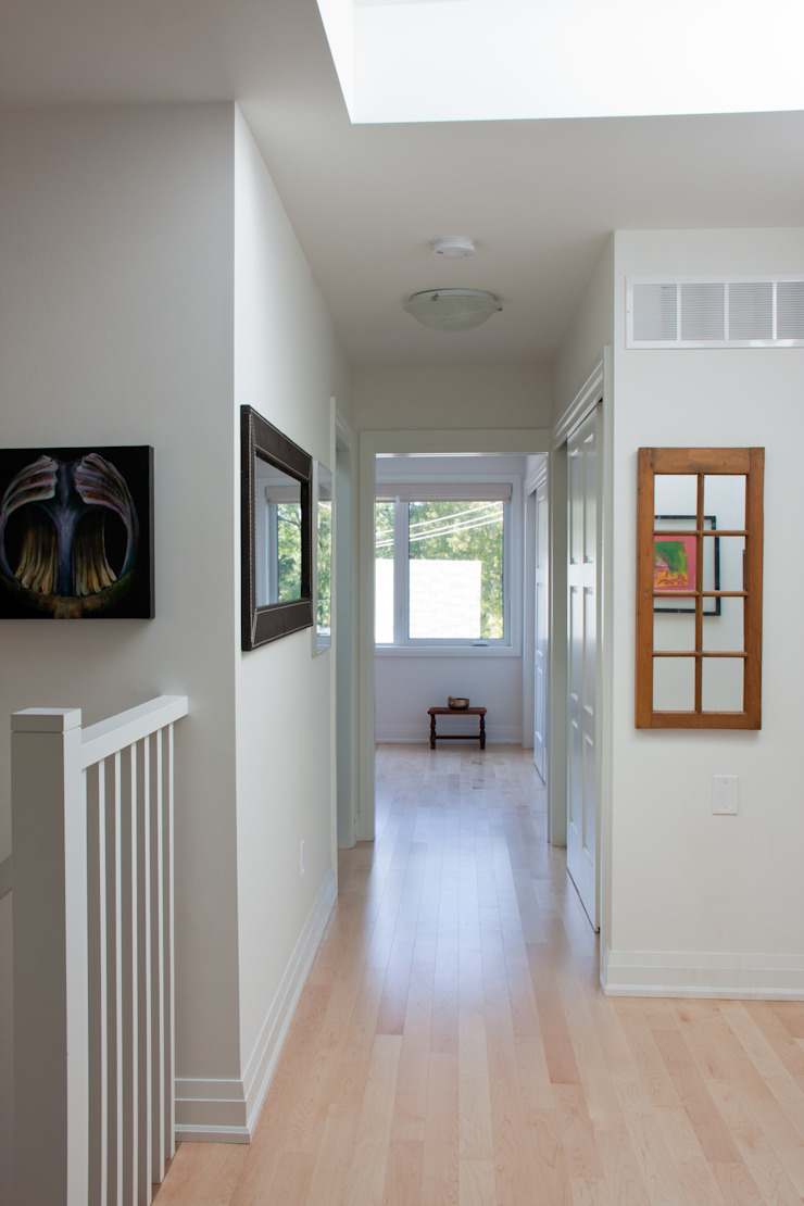 Roncesvalles Accessible House Modern Corridor, Hallway and Staircase by Solares Architecture Modern