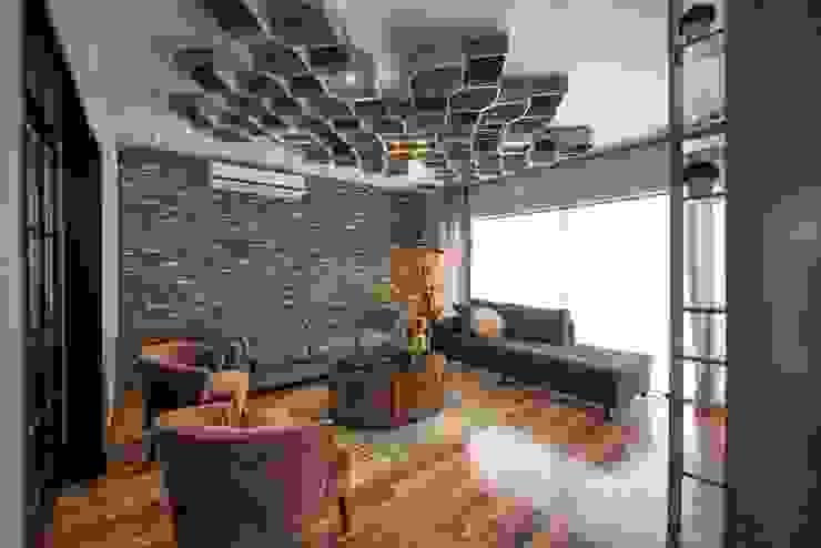 غرفة المعيشة تنفيذ ESTUDIO TANGUMA,
