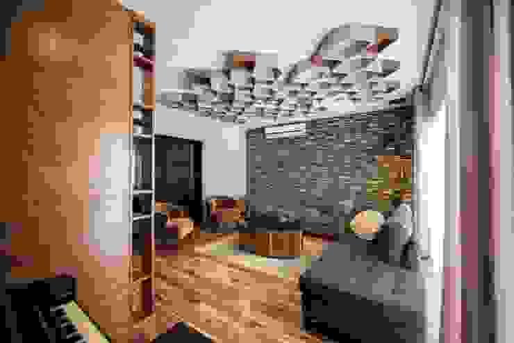 Гостиная в стиле лофт от ESTUDIO TANGUMA Лофт Камень
