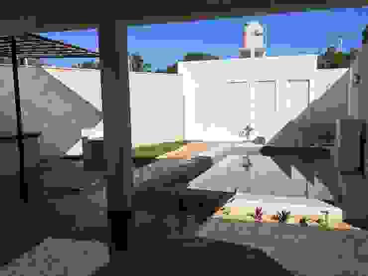 Alberca de chukum Albercas minimalistas de Constructora Asvial - Desarrollador Inmobiliario Minimalista Piedra