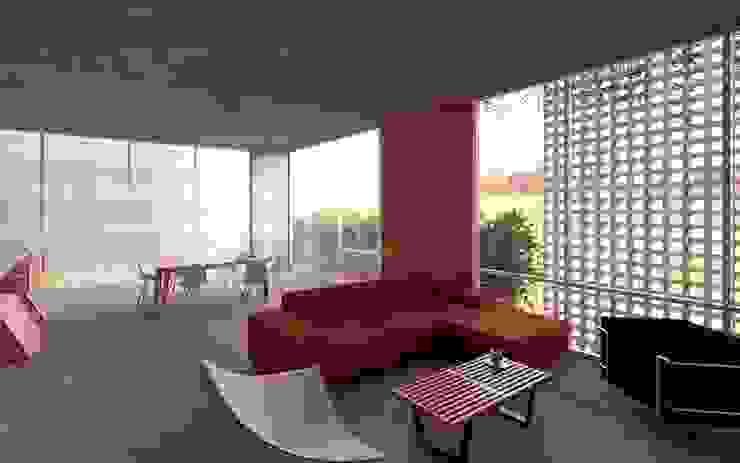 Casa Orta Salones minimalistas de Lozano Arquitectos Minimalista Concreto