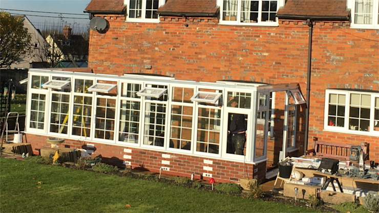 Construction of Conservatory from Pre-Glazed Panels Classic style conservatory by homify Classic